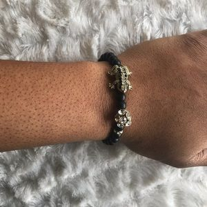 Shop Sale! Hot topic black gold leap frog bracelet
